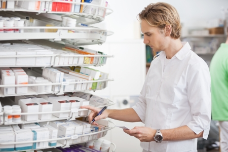out of order: Male Pharmacist Filling Prescription Stock Photo