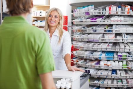 helpful: Helpful Pharmacist Employee Stock Photo