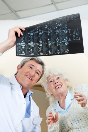 x ray equipment: Doctor And Patient Looking At X-ray
