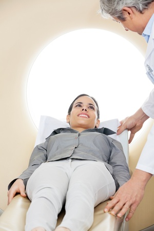 ct: Doctor Preparing Woman For CT Scan Test