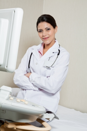Female Radiologist Sitting Hands Folded Stock Photo - 17100209