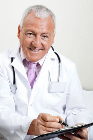 Doctor Writing On Clipboard Stock Photo - 17100192