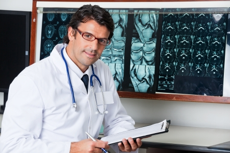 Radiologist At Desk With Clipboard