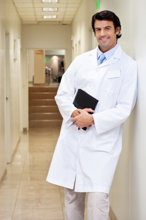 Happy Male Doctor Holding Book Stock Photo - 17100249