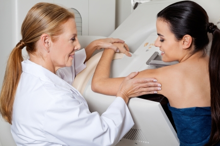 women breast: Doctor Assisting Patient During Mammography