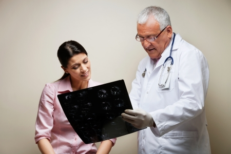 Radiologist And Patient Looking At X-ray Stock Photo - 17100195