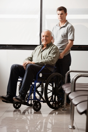 Man With Grandfather Sitting In Wheelchair Stock Photo - 17100198