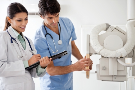 Radiologist And Technician Working Together Stock Photo - 17100200