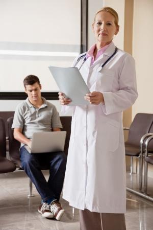 Female Doctor Holding File Stock Photo - 17100196