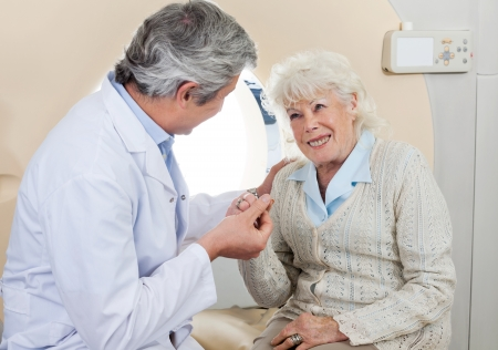 ct scan: Doctor Comforting Senior Female Patient