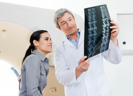 radiogram: Radiologist And Patient Looking At X-ray