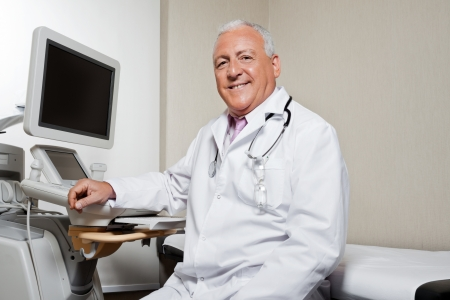 Radiologist Sitting By Ultrasonic Machine photo