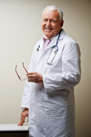 Senior Male Doctor Smiling Stock Photo - 17125102