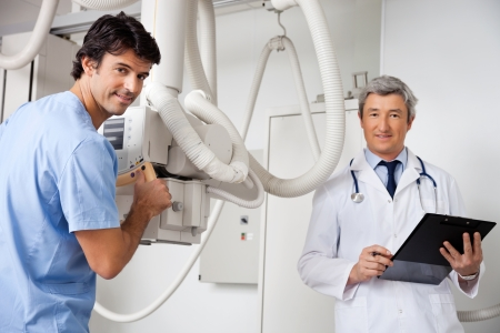 radiologist: Technician And Radiologist At Clinic