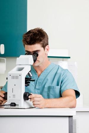 Male Researcher Using Microscope In Laboratory Stock Photo - 17132834