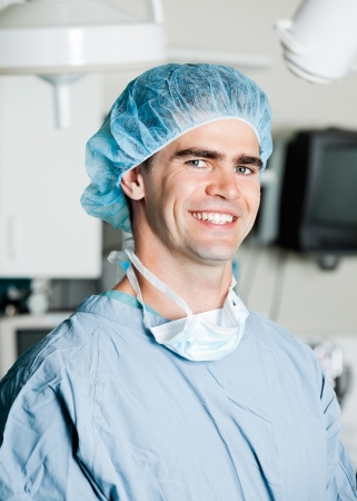 Cheerful Male Surgeon In Operating Room photo