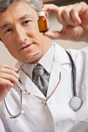 Doctor Holding Medicine Bottle photo
