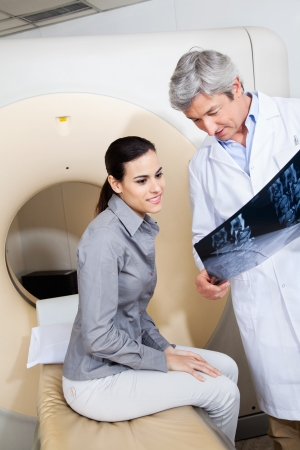 animal doctor: Radiologist Showing X-ray To Female Patient Stock Photo