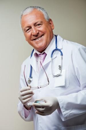 sterilized: Doctor Holding Sterilized Syringe