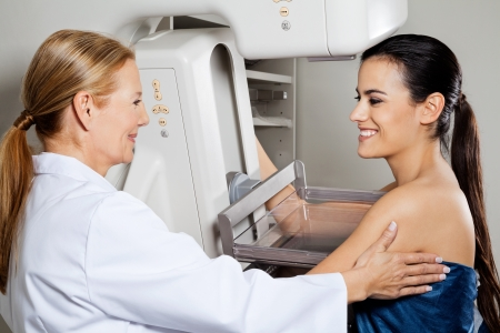 cancer x ray: Doctor With Patient Getting Mammogram X-ray Test Stock Photo