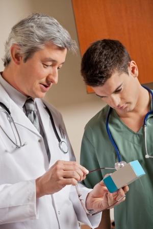 Medical Professionals Looking At Medicine Box Stock Photo - 17166941