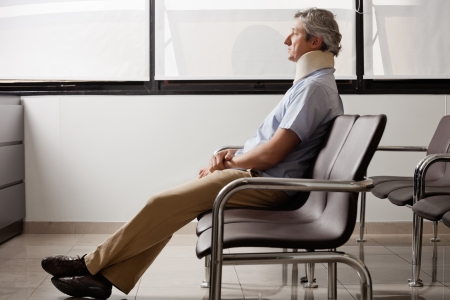injured woman: Man With Neck Injury Waiting In Lobby