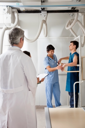 Medical Team With Patient In X-ray Room photo