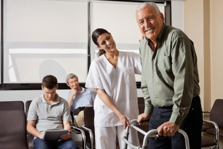 Nurse Helping Senior Patient With Walker photo