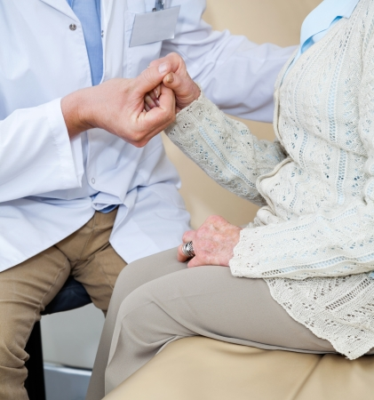 Doctor Comforting Female Patient Stock Photo - 17167086