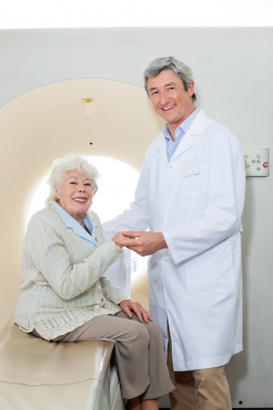 Happy Doctor And Female Patient photo