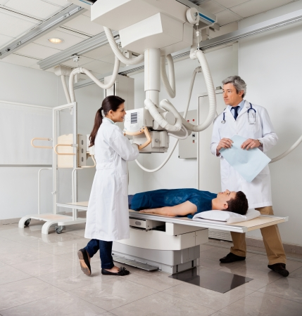 radiographic: Radiologists With Patient In X-ray Room