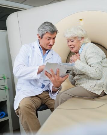 ct scan: Doctor Explaining Female Patient