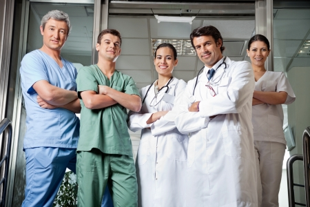 Medical Professionals Standing With Hands Folded photo