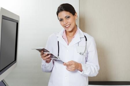 Female Radiologist Holding Sonography Print Stock Photo - 17213633