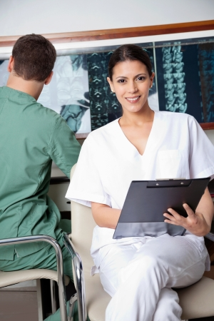 Female Medical Technician Holding Clipboard Stock Photo - 17213640