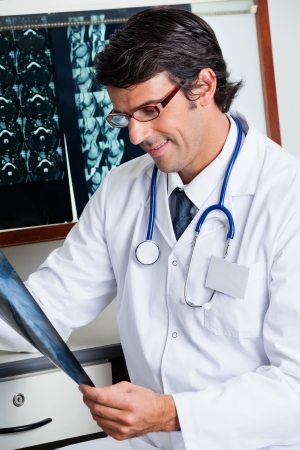 Male Radiologist Reviewing X-ray photo