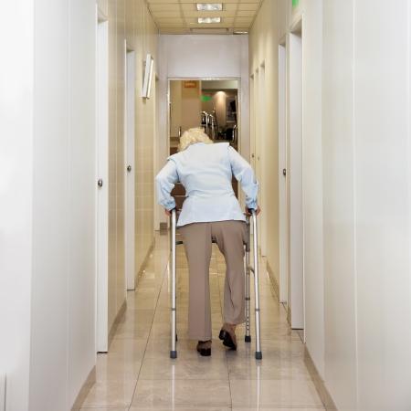 Woman With Walker In Corridor