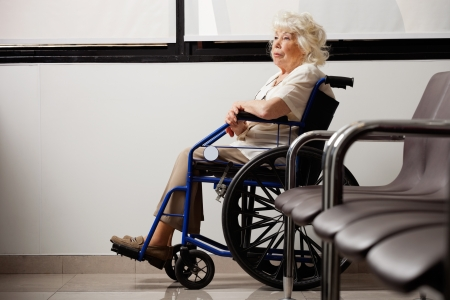 Pensive Elderly Woman On Wheelchair photo