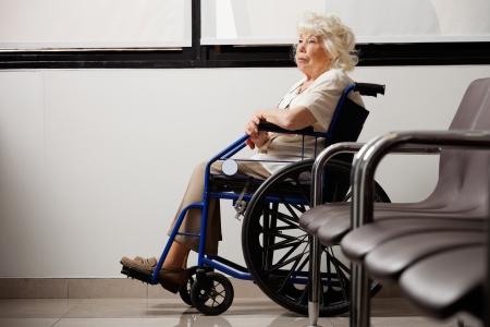 Pensive Elderly Woman On Wheelchair Stock Photo