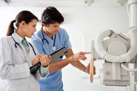 Radiologist And Technician Working At Clinic photo
