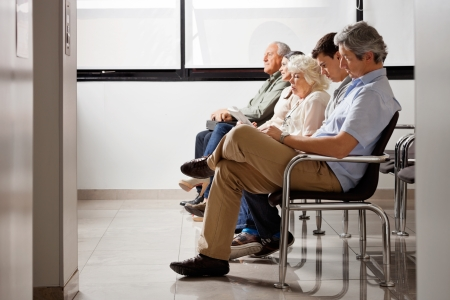 healthcare visitor: People Waiting For Doctor In Hospital Lobby