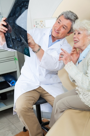 radiogram: Radiologist Explaining X-ray To Patient Stock Photo