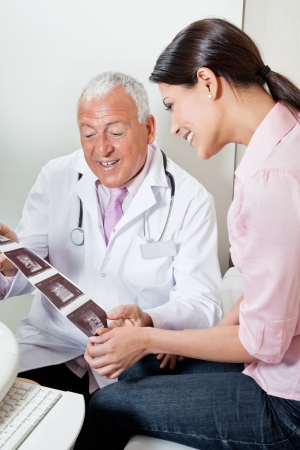 Radiologist Showing Ultrasound Print To Patient Stock Photo - 17238667