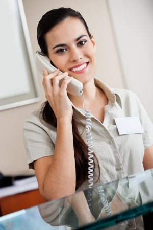 Female Receptionist Answering Call photo