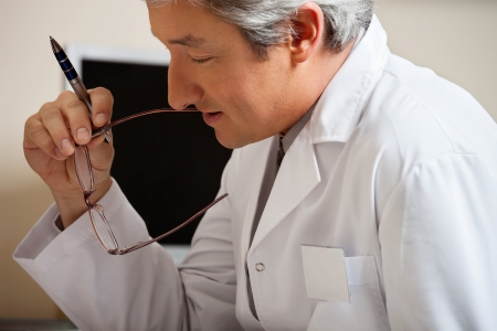 Doctor Holding Pen And Glasses Stock Photo - 17238666