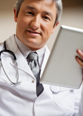 Doctor Holding Digital Tablet photo
