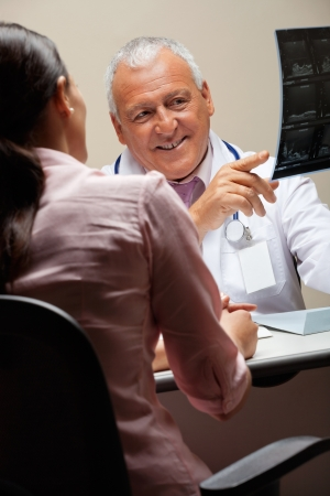 Radiologist Showing X-ray To Patient Stock Photo - 17238661