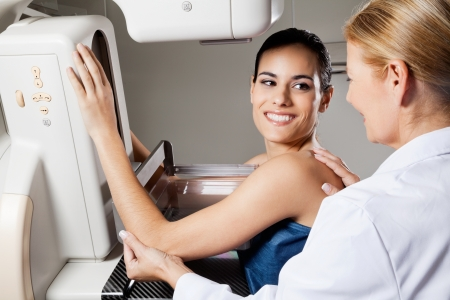cancer x ray: Female Undergoing Mammogram X-ray Test