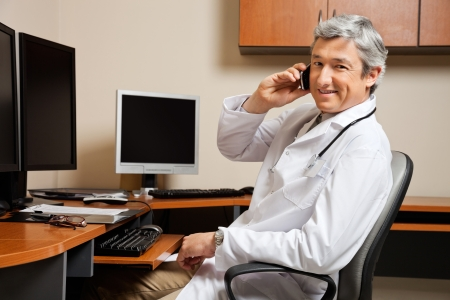 Happy Doctor On Call Stock Photo - 17238670
