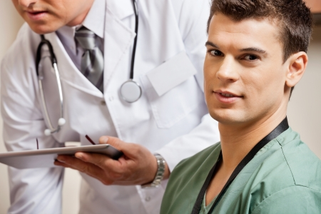 Male Technician With Doctor In Background Stock Photo - 17238692